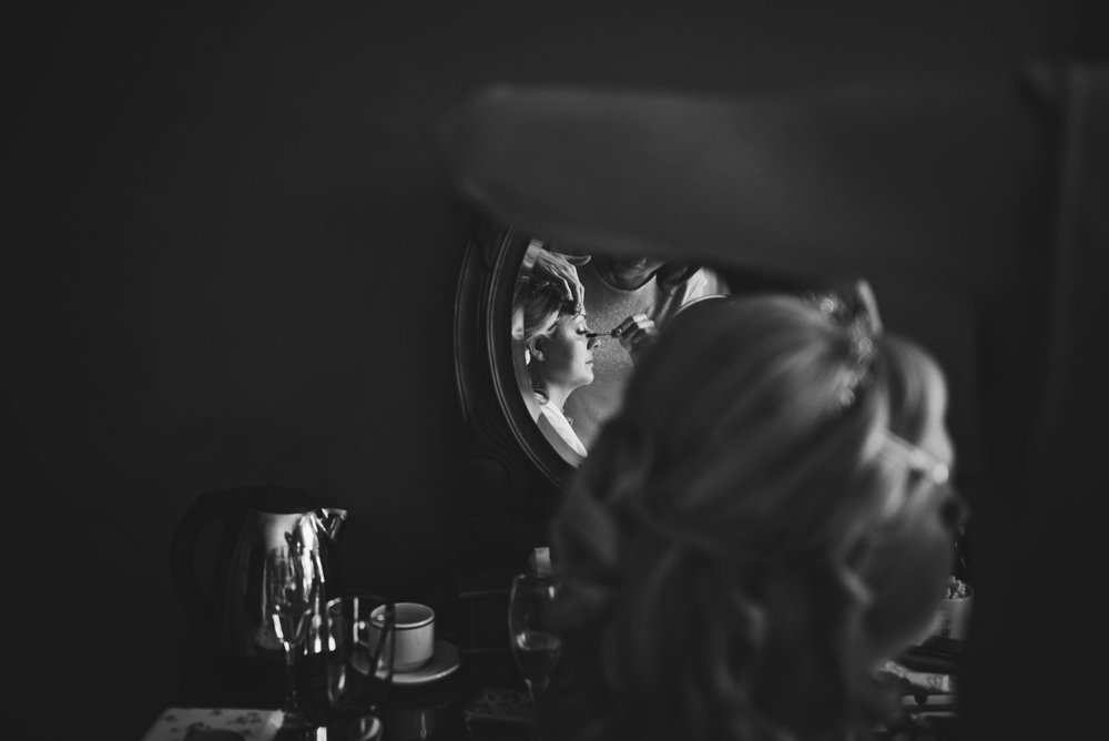 Bride in Mirror at Parklands Quendon Hall wedding Essex UK Documentary Photographer