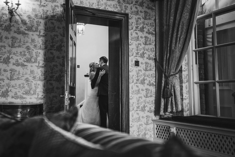 Bride & Groom share tender moment at Parklands Quendon Hall Essex UK Documentary Wedding Photographer