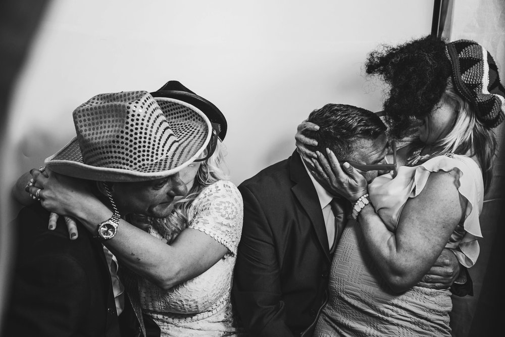 Two couples in photo booth at Quendon Hall Parklands Wedding Essex UK Documentary Photographer