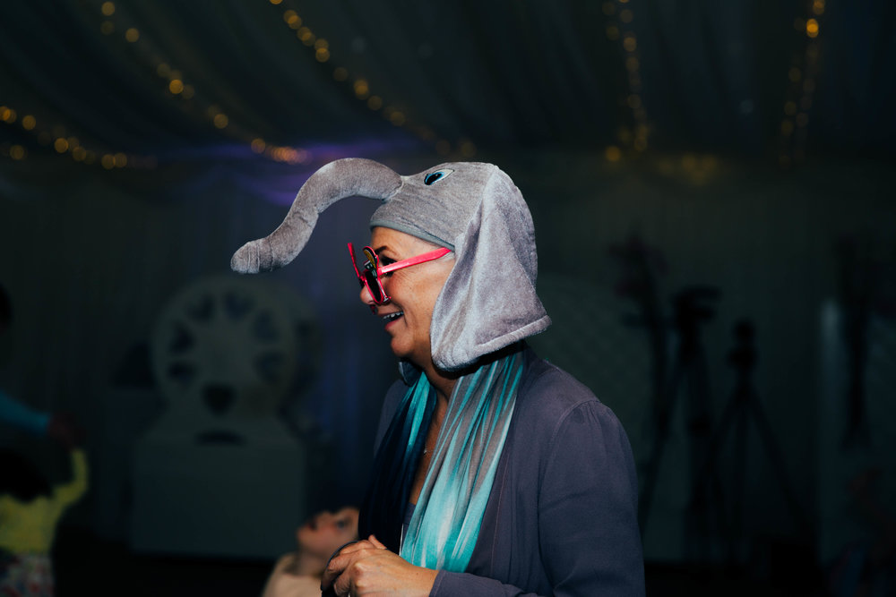 Woman on dance floor in elephant hat at Parklands Quendon Hall Essex UK Documentary Photographer