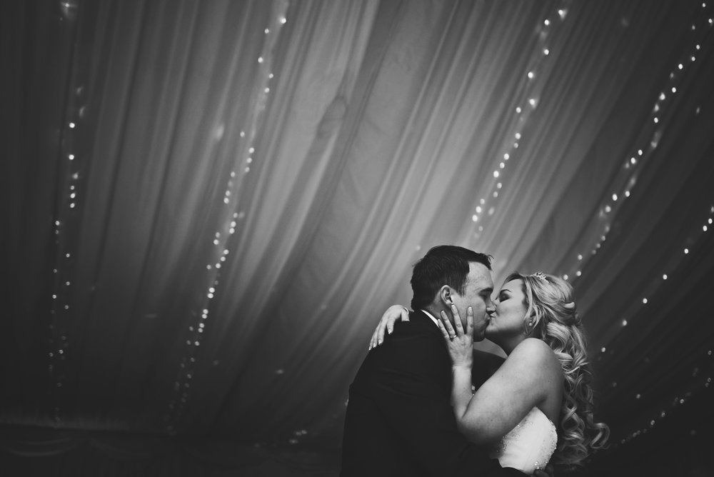 Bride and Groom kiss on dance floor Parklands Quendon Hall Essex UK Documentary Wedding Photographer