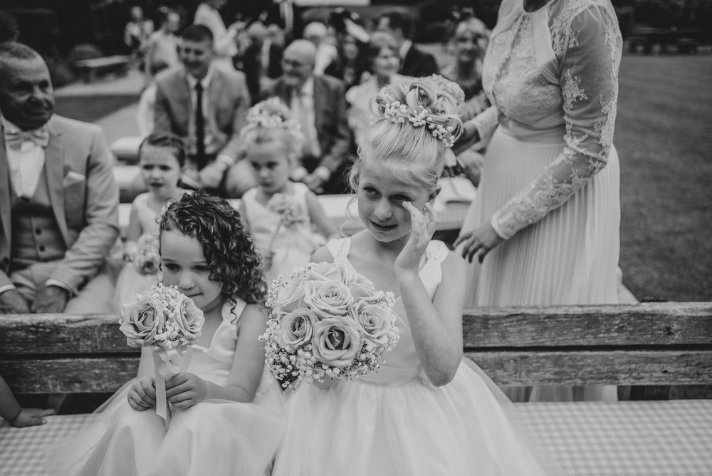 Flower girl cries at parents Blake Hall Wedding Essex UK Documentary Photographer