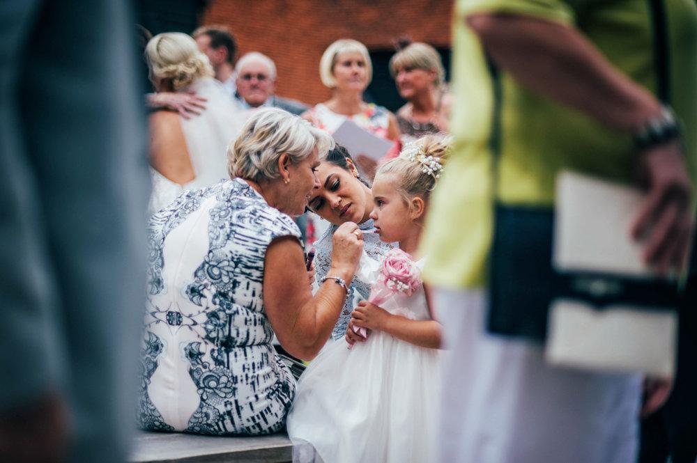 Flower girl gets lip gloss Blake Hall Ongar Essex UK Documentary Wedding Photographer