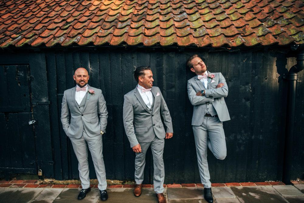 Groom and Groomsmen laugh at Blake Hall Ongar Wedding Essex UK Documentary Photographer