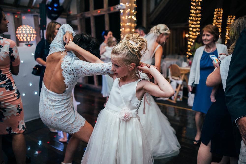 Flower girl on dance floor at Blake Hall Ongar Wedding Essex UK Documentary Photographer