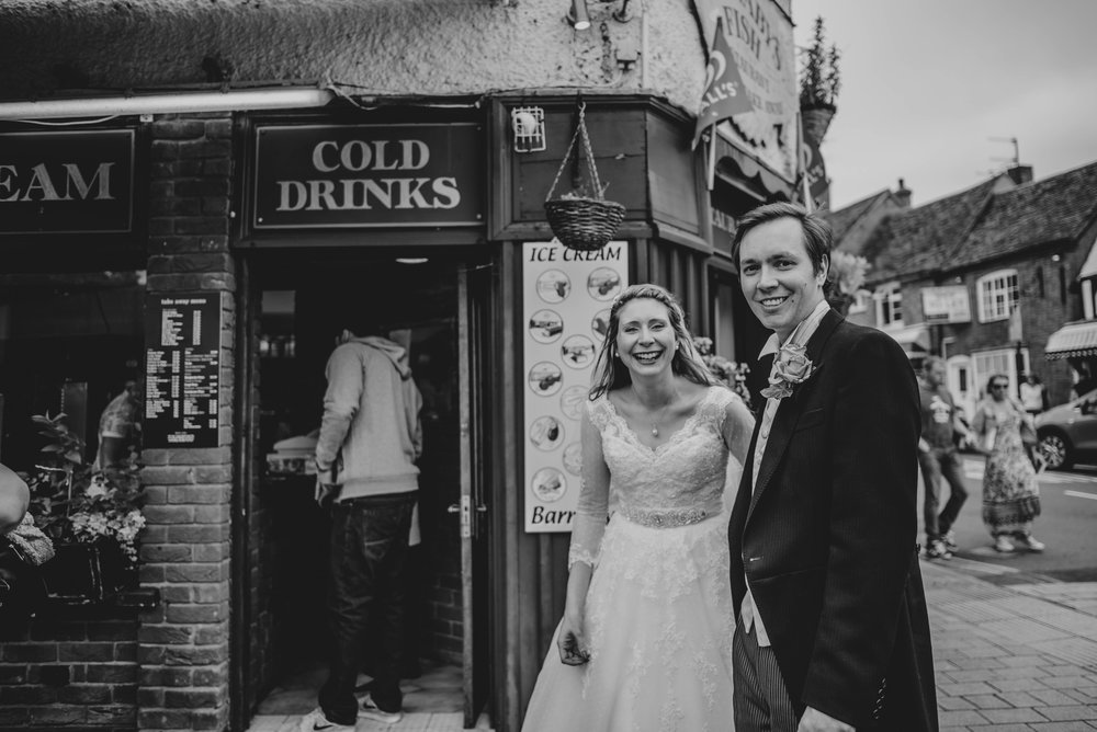 Bride & Groom on streets of Stratford Upon Avon Essex UK Documentary Photographer