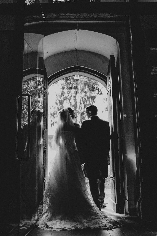 Bride and Groom at church door Surrey Tipi Wedding Essex UK Documentary Wedding Photographer