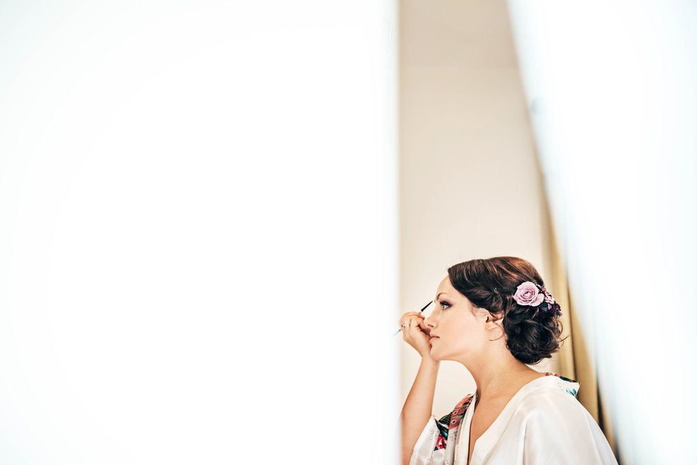 Bride does make up Dewsall Court Wedding Essex UK Documentary Photographer