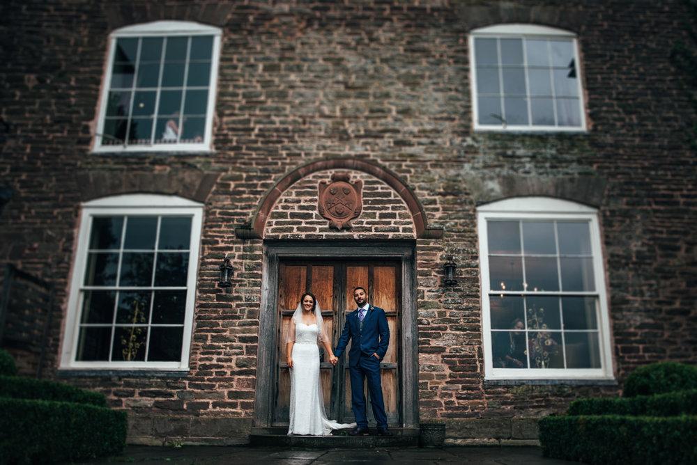 Bride & Groom Rainy day Wedding Dewsall Court Essex UK Documentary Photographer