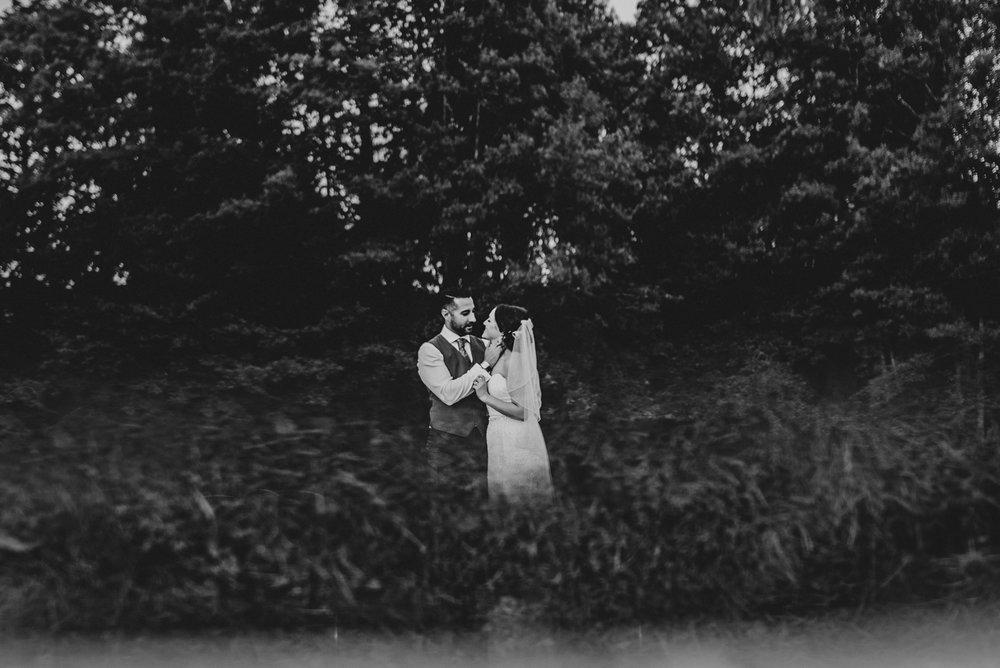 Bride & Groom Kiss for rainy Dewsall Court Wedding Essex UK Documentary Photographer