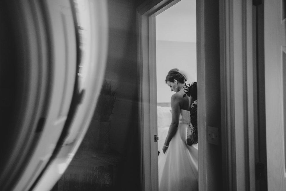 Bride puts on Pronovias Dress DIY Farm Wedding Essex UK Documentary Wedding Photographer