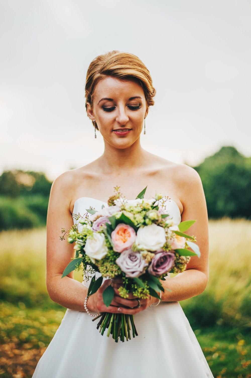 Bride in Pronovias for DIY Farm Wedding Essex UK Documentary Photographer