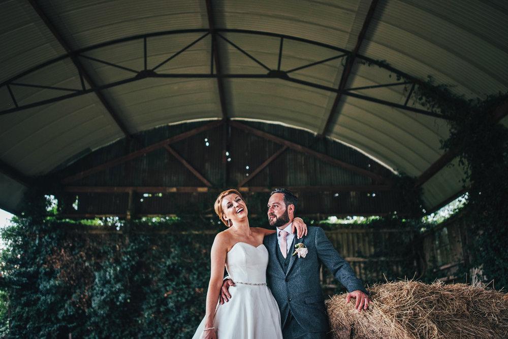 Bride & Groom in Hay Barn at DIY Farm Wedding Essex UK Documentary Wedding Photographer