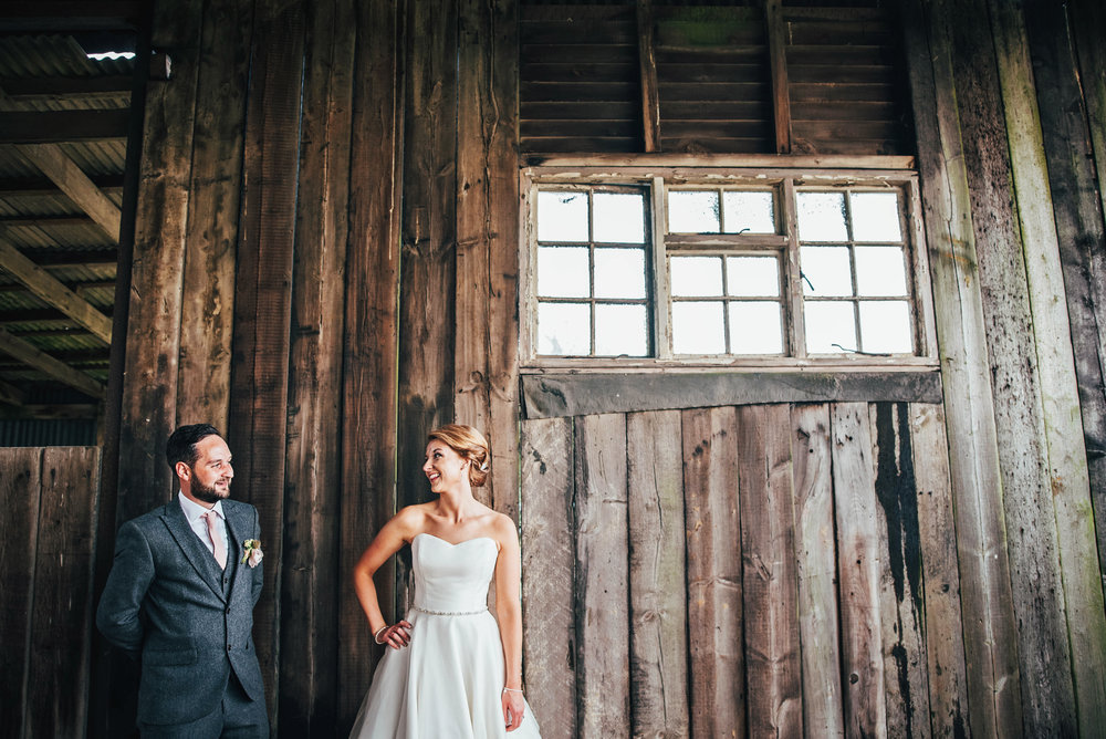 Bride & Groom in Barn for Essex Farm DIY Wedding UK Documentary Photographer