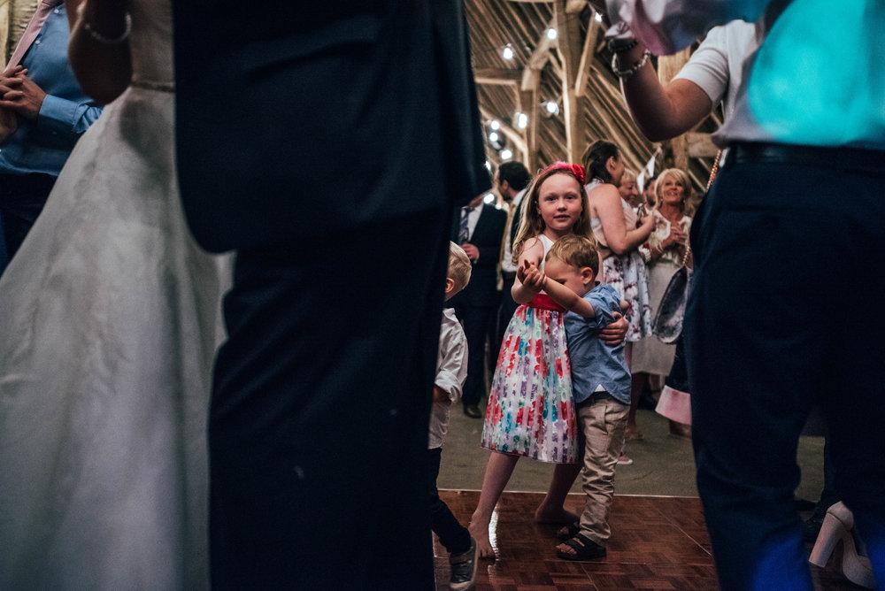 Kids on dance floor at DIY Farm Wedding Essex UK Documentary Wedding Photographer
