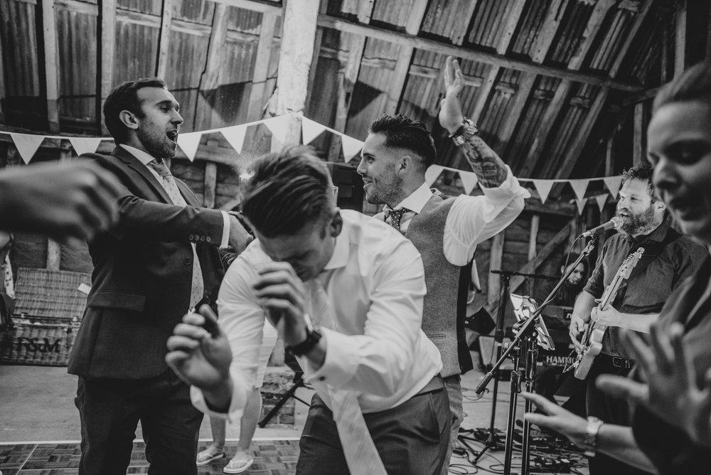 Guests on dance floor at DIY Farm Wedding Essex UK Documentary Photographer