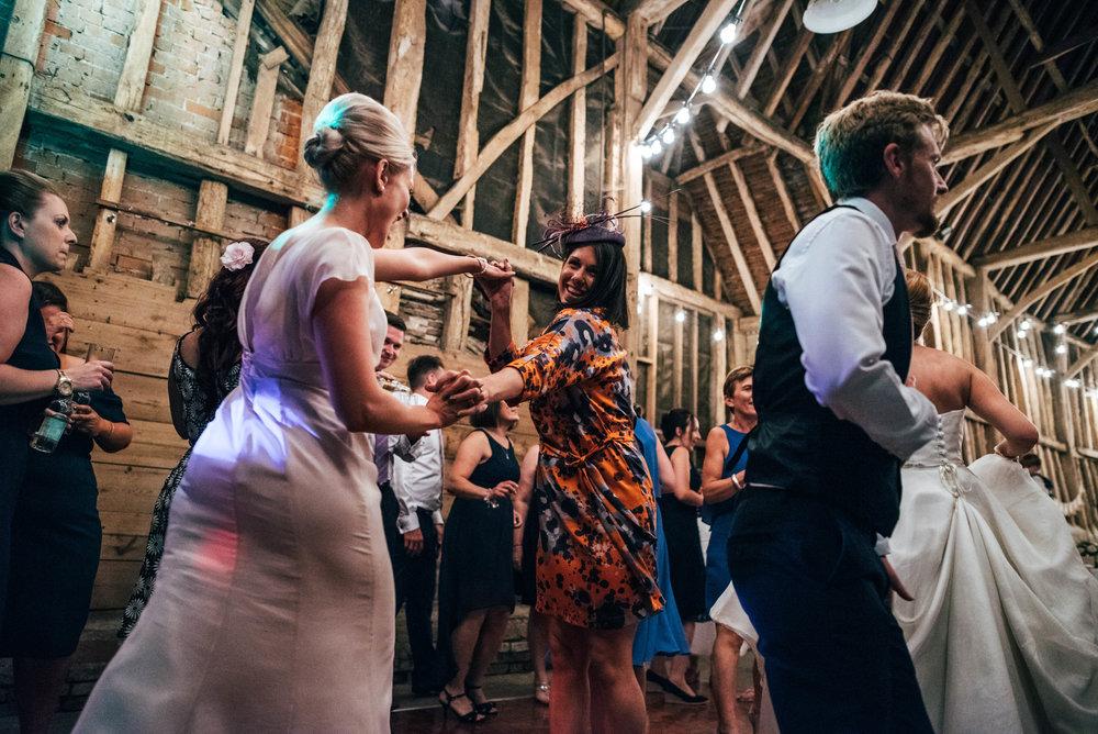 Guest on dance floor DIY Farm Wedding Essex UK Documentary Wedding Photographer