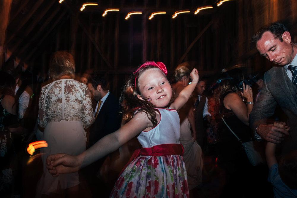 Girl on dance floor at DIY Farm Wedding Essex UK Documentary Wedding Photographer