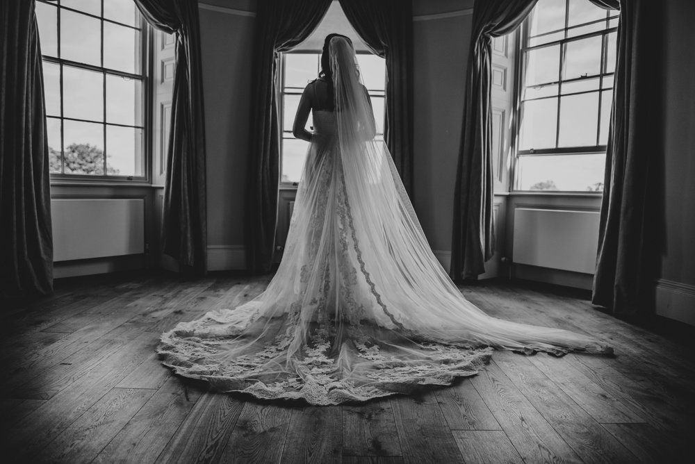 Bride in veil at Hylands House Chelmsford Essex UK Documentary Wedding Photographer