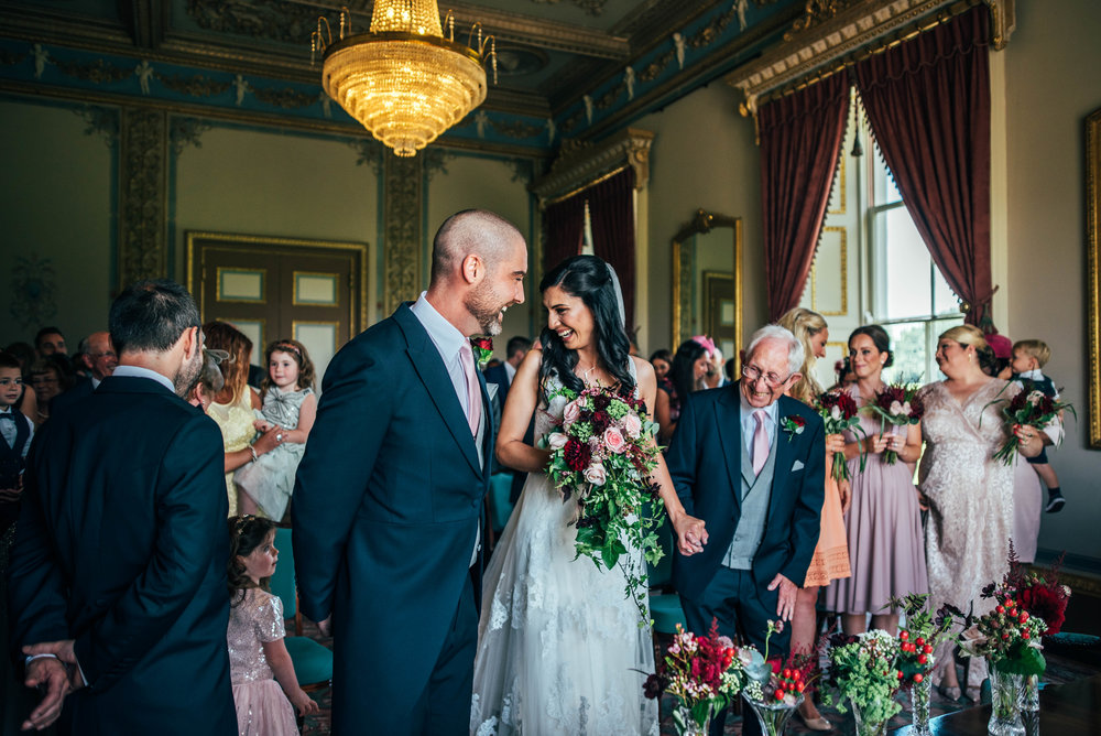 Bride and Groom laugh Hylands House Chelmsford Essex UK Documentary Wedding Photographer