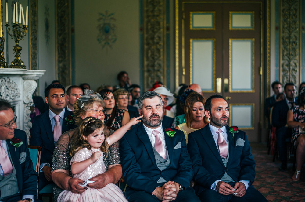 Little girl pokes Dads face Hylands House Chelmsford Wedding Essex UK Documentary Photographer