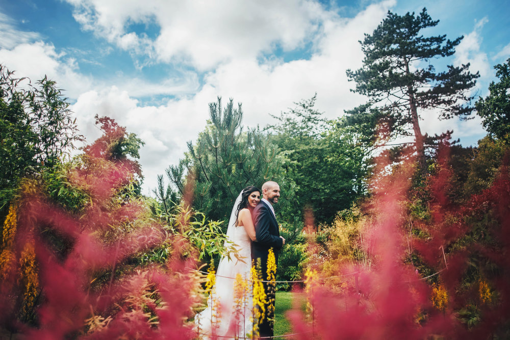Bride & Groom in Gardens at Hylands House Chelmsford Essex UK Documentary Photographer