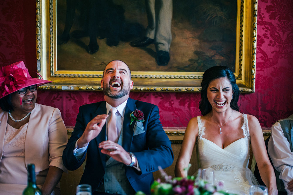 Bride & Groom laugh at speeches for Hylands House Chelmsford Wedding Essex UK Documentary Photographer