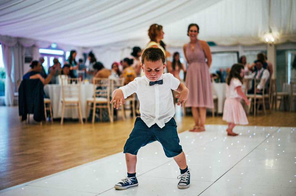 Little Boy on dance floor at Hylands House Chelmsford Wedding Essex UK Documentary Photographer