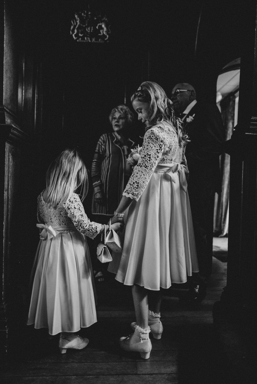 Flower girls hold hands at Baddow Park Essex UK Documentary Wedding Photographer