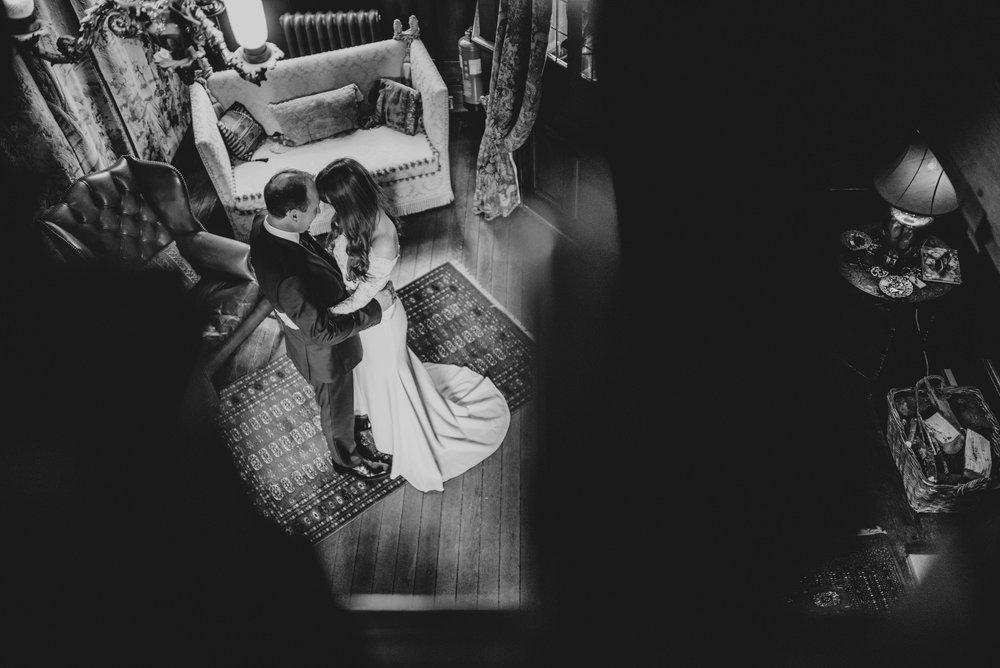 Bride and Groom in Hallway at Baddow Park Chelmsford Essex UK Documentary Wedding Photographer