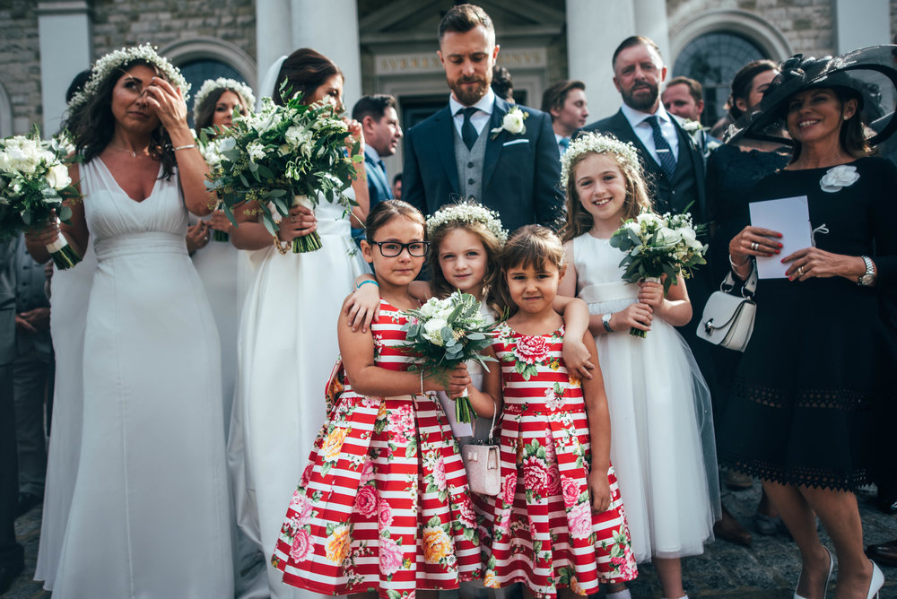 Little girls outside Brentwood Cathedral Blake Hall Ongar Wedding Essex UK Documentary Wedding Photographer