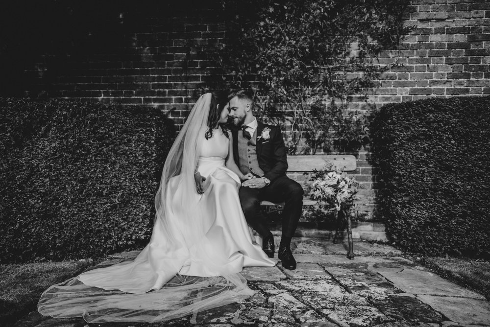 Bride and Groom share moment in gardens Blake Hall Ongar Essex UK Documentary Wedding Photographer