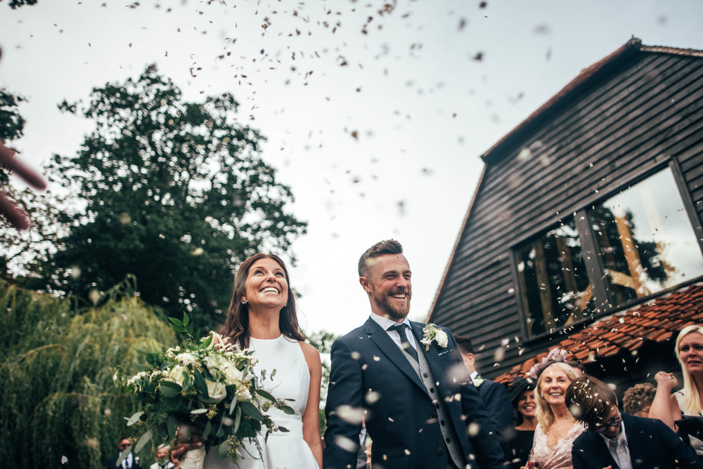 Bride Groom confetti elegant Brentwood Cathedral Blake Hall Ongar Wedding Essex UK Documentary Photographer