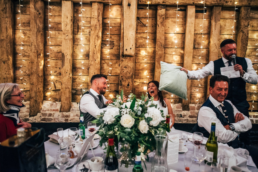 Bride and Groom laugh speeches Blake Hall Ongar Essex UK Documentary Wedding Photographer