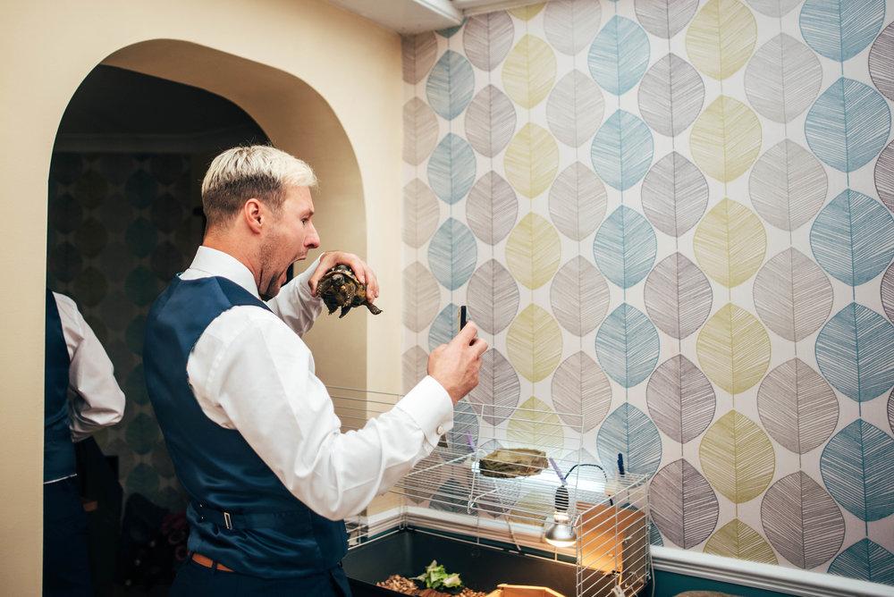 Best Man take selfie with tortoise Maidens Barn Chelmsford Essex UK Documentary Wedding Photographer