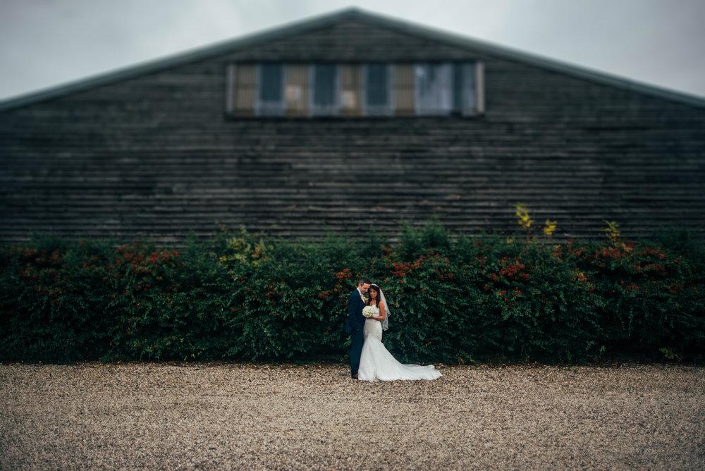 Bride Groom outside Barn Maidens Barn Chelmsford Essex UK Documentary Wedding Photographer