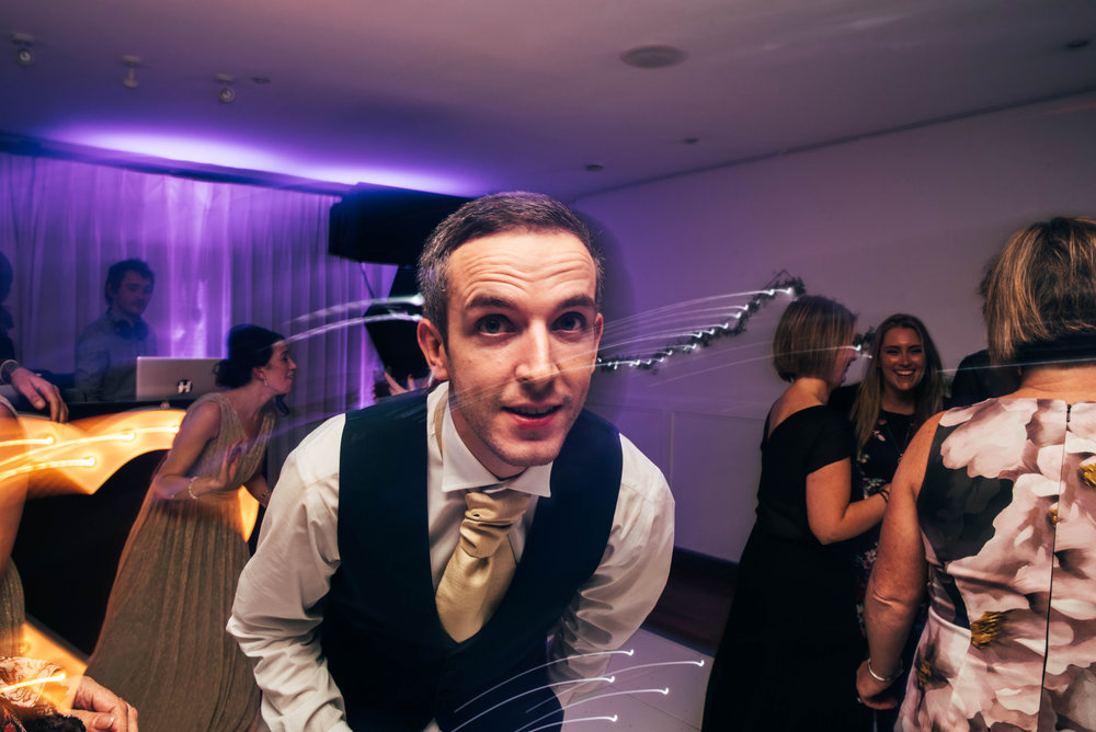 Groom on dance floor Maidens Barn Essex UK Documentary Wedding Photographer