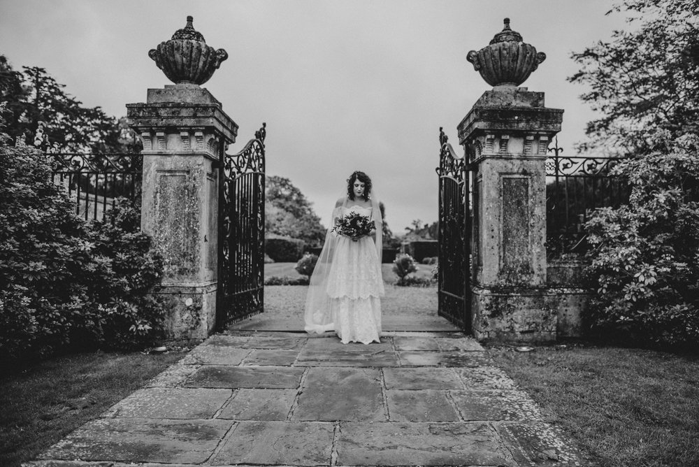 Bride in 80s vintage Dress Gothic DIY Rotherwick Village Hall Wedding Essex UK Documentary Photographer