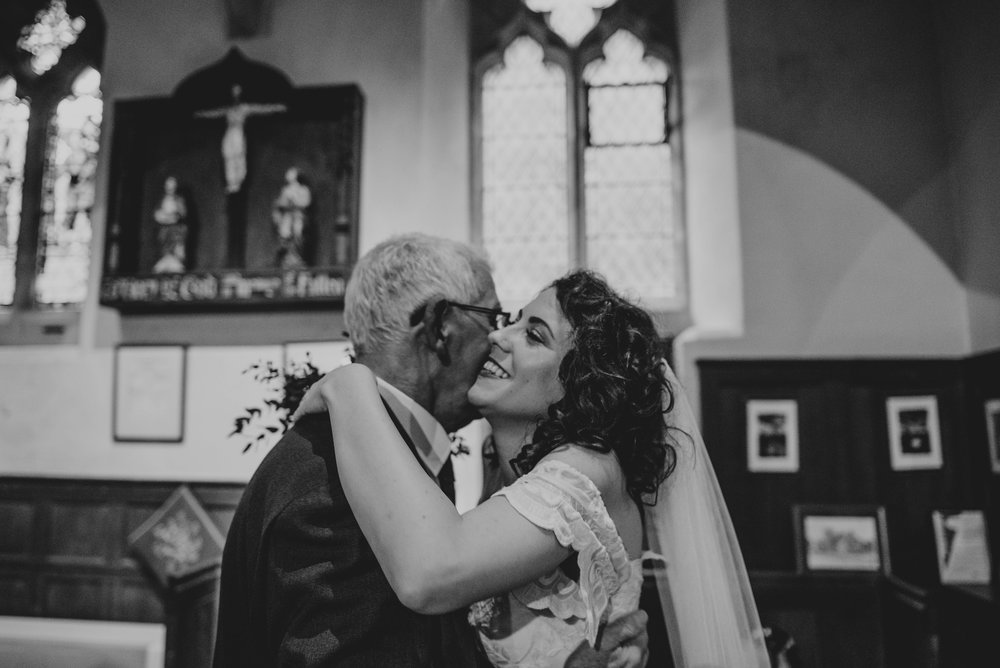 Bride kiss Grandfather Gothic Vintage DIY Rotherwick Village Hall Essex UK Documentary Wedding Photographer