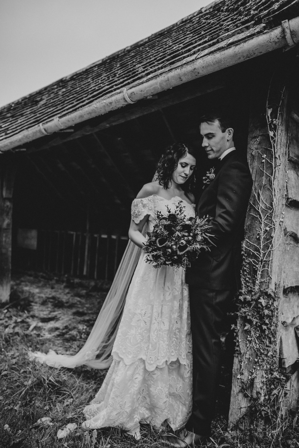 Bride & Groom in stable Rotherwick Village Hall DIY Wedding Vintage 80s dress Essex UK Documentary Photographer