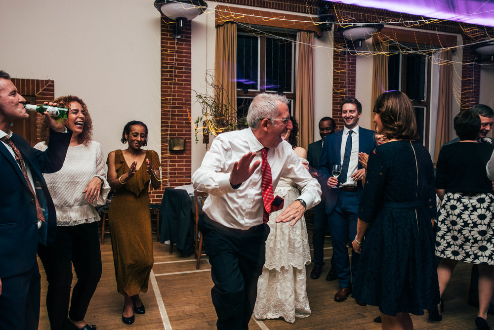Father of Bride on dance floor at Gothic 80s vintage DIY Rotherwick Village Hall Wedding Essex UK Documentary Photographer