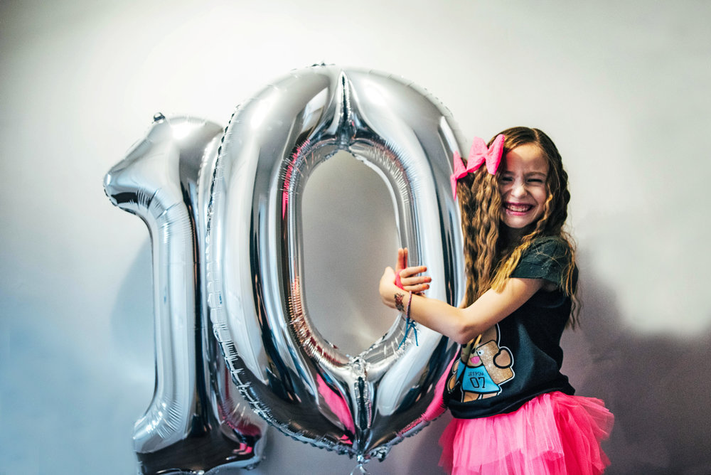 Young girl with 10 balloon Essex UK Documentary Photographer