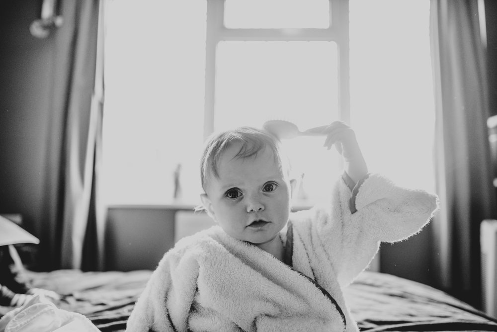 Baby girl brushes hair after bath Essex UK Family Childhood Lifestyle Photographer