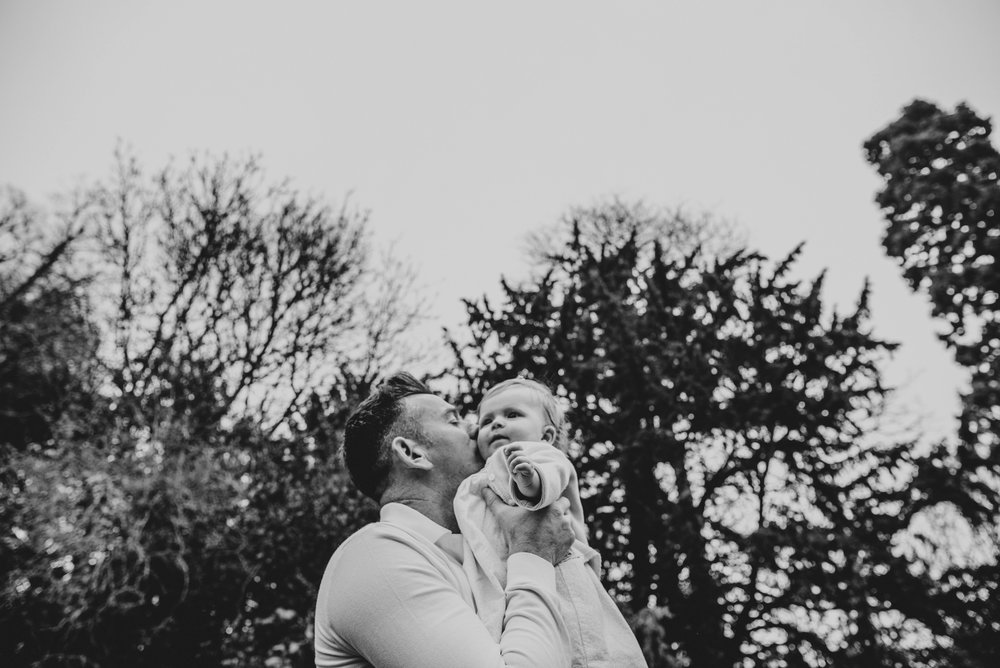 Young Parents with baby girl in Essex park for Spring Portraits