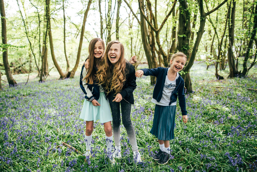 Three girls in Bluebell woodland Essex UK Documentary Lifestyle Portrait Photographer