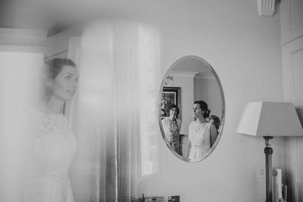 Alternative diy wedding on a boat with steam fairground Essex UK Documentary Wedding Photographer Bridal Prep Double exposure