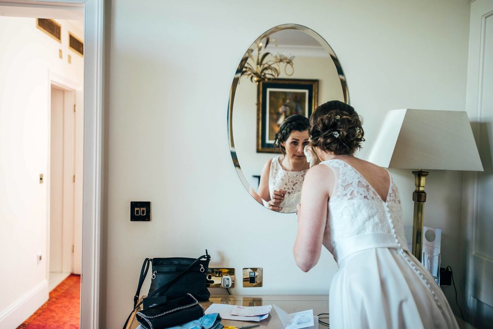 Alternative diy wedding on a boat with steam fairground Essex UK Documentary Wedding Photographer bridal prep