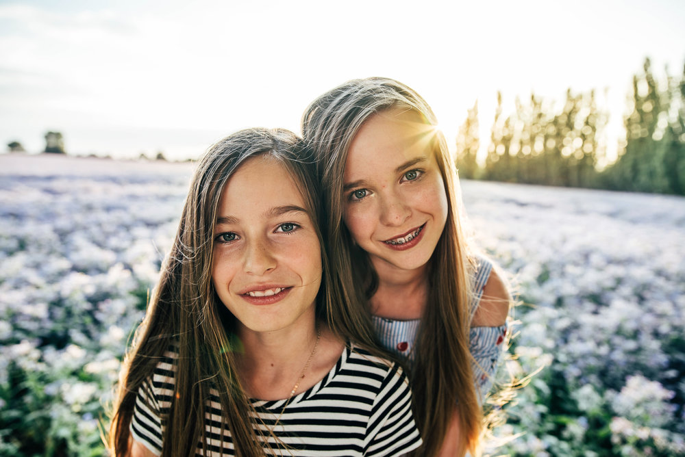 Two sisters in purple field at sunset Essex UK Documentary Portrait Photographer