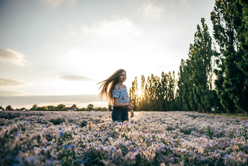 teen girl in purple field at sunset Essex UK Documentary Portrait Photographer