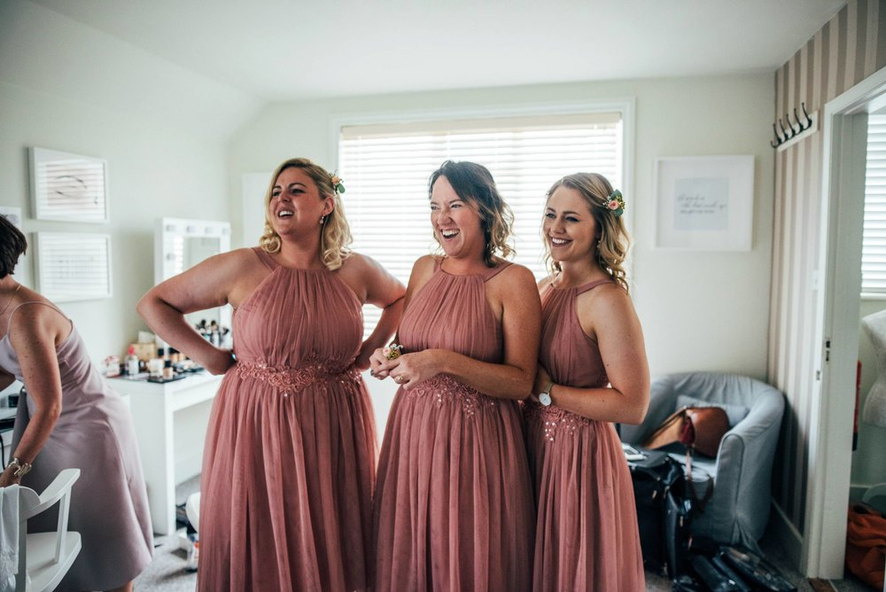Boho Chic Fennes Essex Wedding Blush with hints of Copper Bride wears Lillian West Essex Documentary Wedding Photographer